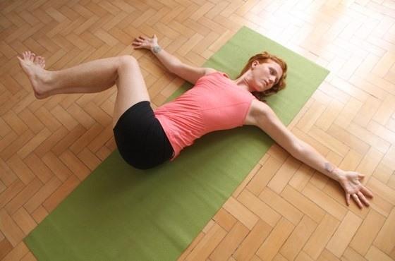 Yoga reclining spinal twist