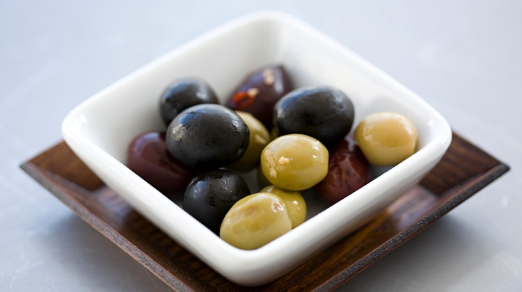 Different types of olives in bowl
