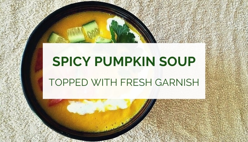 Spicy pumpkin soup topped with fresh garnish and yogurt