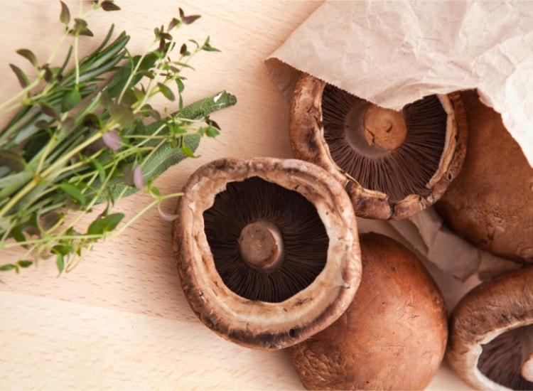 Portobello mushrooms in paper bag