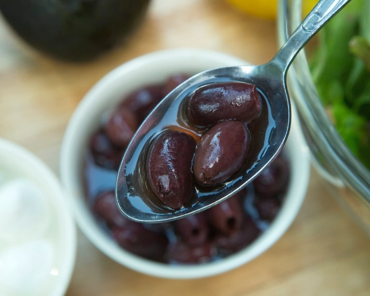 Kalamata olives on a spoon