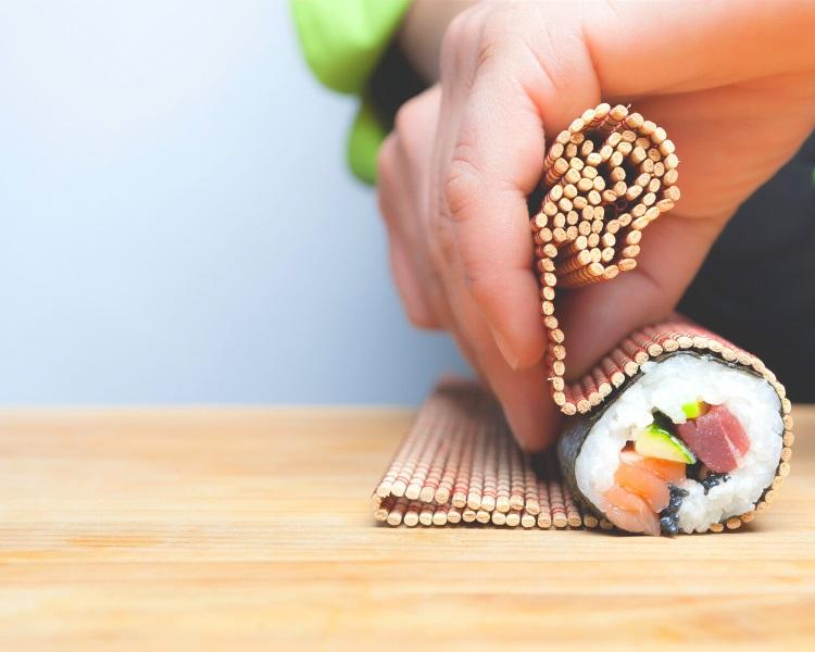 Making sushi roll with nori sheet