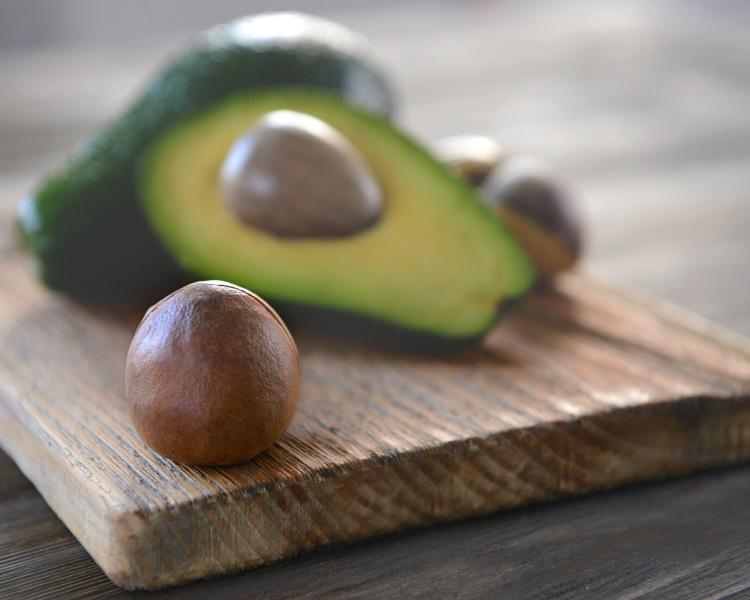 Avocado seed on cutting board